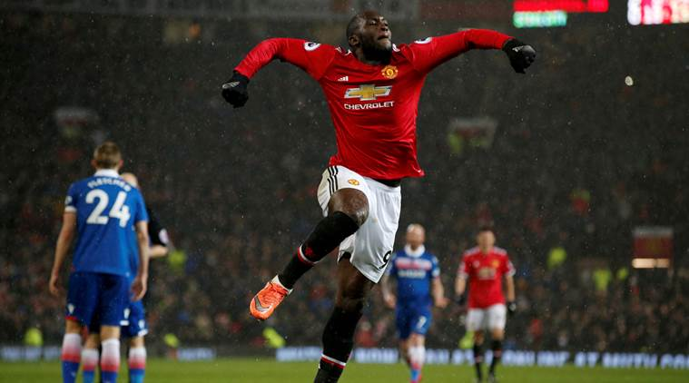 Man United beat Stoke 3-0, reduce City's lead to 12 points
