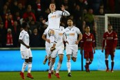 Battling Swansea shock Liverpool