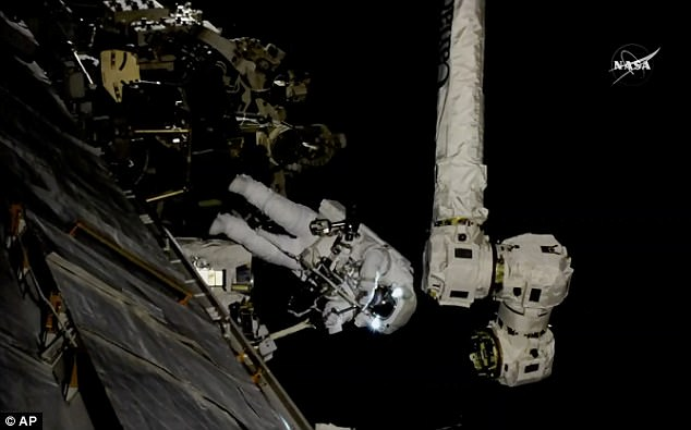 Spacewalking astronauts onboard the ISS give new hand to robot arm