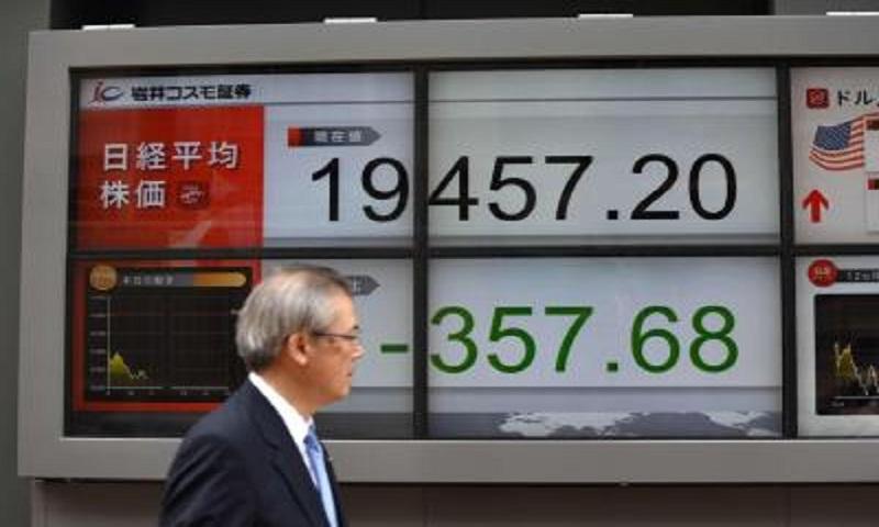 Tokyo stocks open lower after Wall Street falls