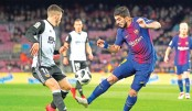 Suarez gives Barca edge in Copa del Rey semi