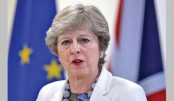 May under pressure as Conservatives at war over Brexit