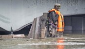 Standing partially submerged after the River Seine burst its banks in Paris