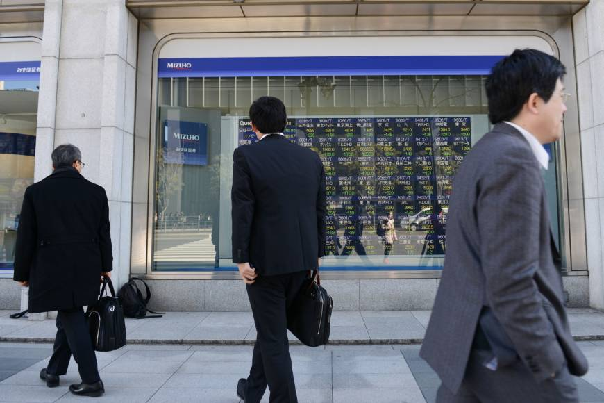 Tokyo stocks open higher after volatile trade