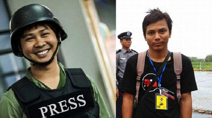 Reuters says journalists for probing Rohingya massacre