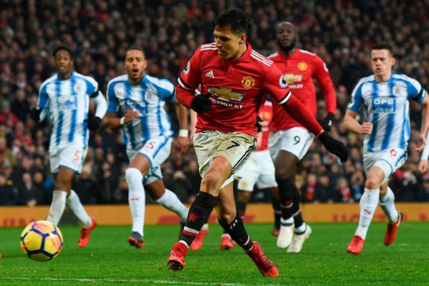 Manchester United beat Huddersfield 2-0, sets up last 8 clash with Brighton