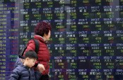 Asian shares gain on rosy Japan data, bucking Wall St losses