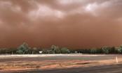 Dust storm blankets Australian town in orange