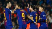 Suarez hat-trick extends six-goal Barca's La Liga lead