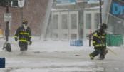 8 killed as winter storm, floods batter US