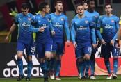 Arsenal stun Milan to ease pressure on Wenger