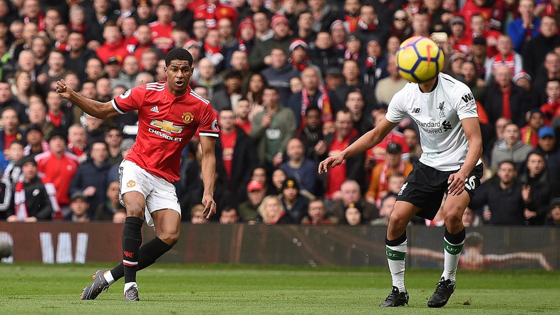 Rashford hits double as Manchester United hold off Liverpool