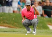 Woods closes to within 1 shot of Canadian rookie Conners