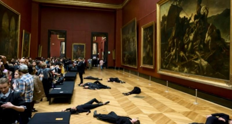 Climate protest prompts partial evacuation at Louvre