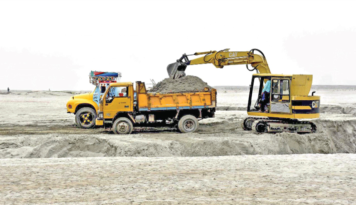 Illegally quarrying sand