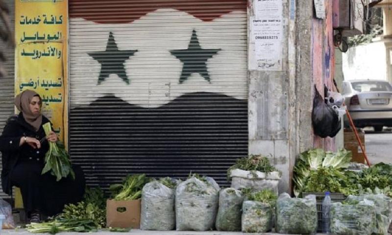 Syria war: 35 civilians killed as rockets hit Damascus market