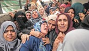 Palestinians mourn as Gaza attack toll rises to 16