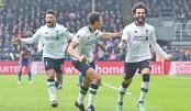 Salah strikes to take Liverpool to second