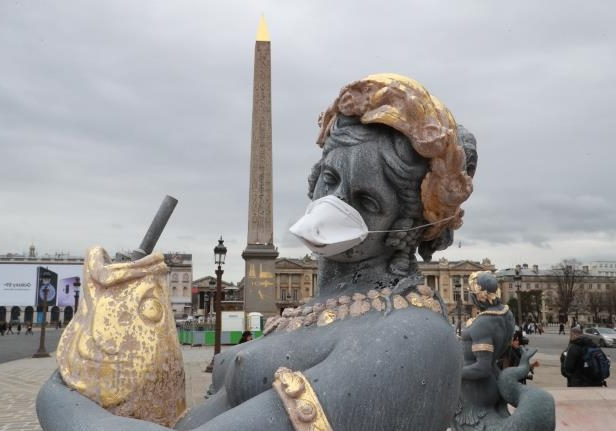 French statues get anti-pollution masks in clean air protest