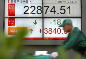 Tokyo drives Asia stocks higher in light holiday trade