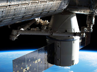 SpaceX capsule reaches space station with food, experiments