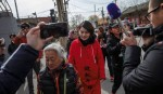 Detained Chinese lawyer wife marches  for answers
