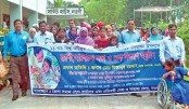 Naogaon district administration takes out a procession