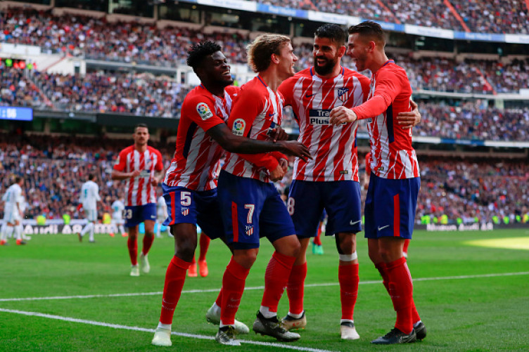 Ronaldo continues goal spree but Real Madrid held by stubborn Atletico Madrid