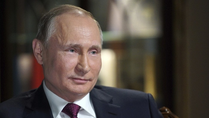 Putin earns $302,000 in 2017