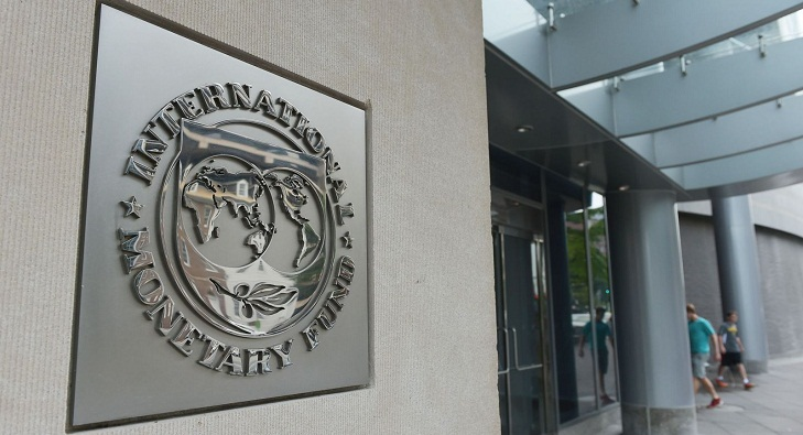 IMF sees solid near-term global growth but risks beyond