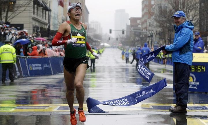 Japan hails school clerk who won Boston Marathon