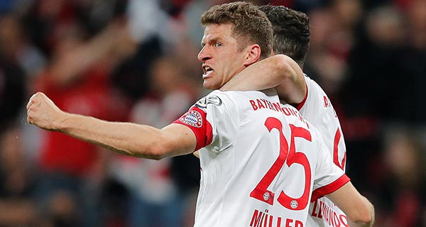 Bayern reaches German Cup final with 6-2 win in Leverkusen