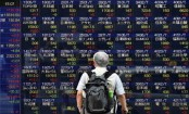 Tokyo stocks open lower as attention shifts to earnings