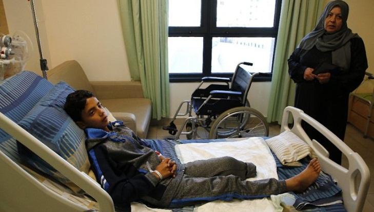 Palestinian boy's leg amputated after Israel border shooting