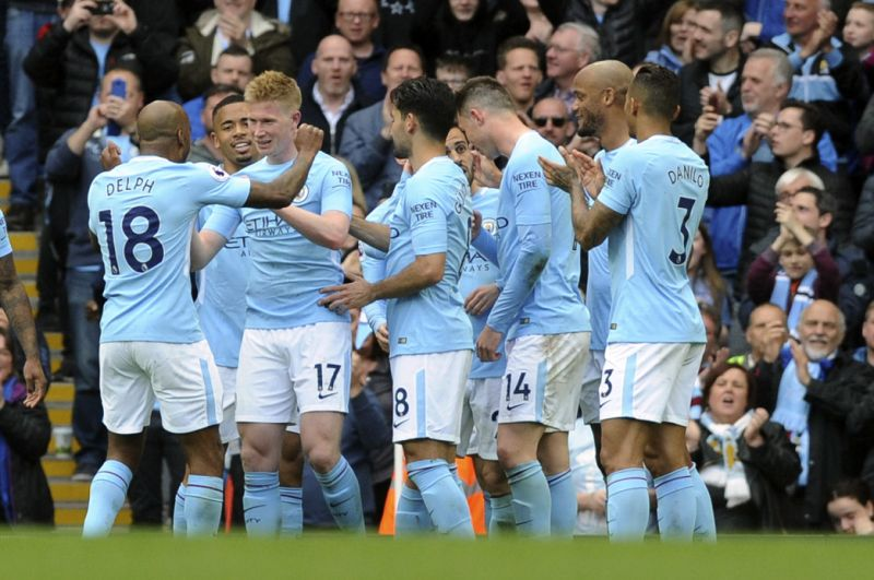 Chasing records, EPL champion Man City thrashes Swansea 5-0