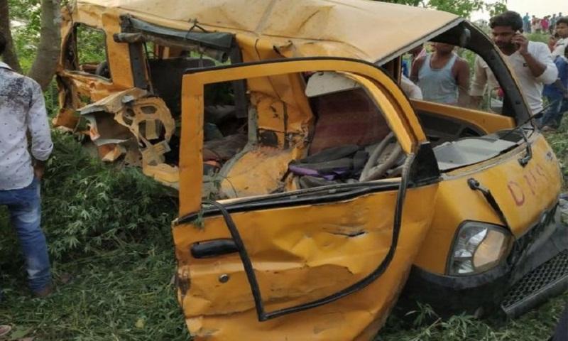 Thirteen children die as India school bus hits train