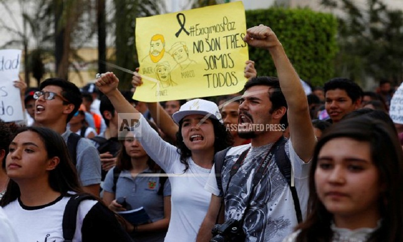 Thousands protest brutal killings of 3 Mexican film students