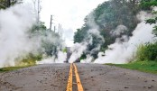 Steam rises from a fissure on a road