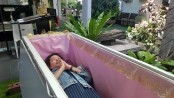 This 'death cafe' in Bangkok lets you lie in a coffin to get discounts on drinks