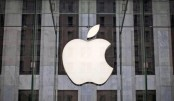 Apple hits record high after buffet's co raise stake
