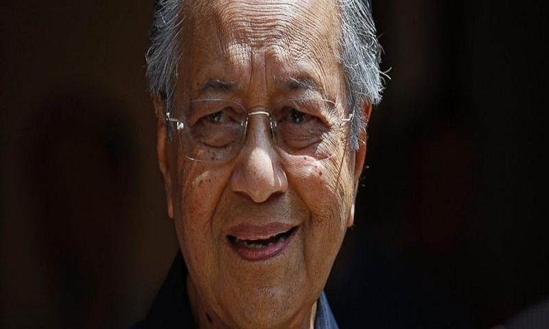 Malaysia's Mahathir plans lean cabinet, seeks Anwar's pardon