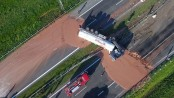 What a sight! Tons of liquid chocolate spills on to highway after crash (Video)