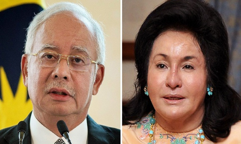 Najib Razak and wife barred from leaving country