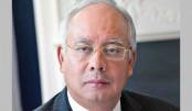 Najib, wife banned from leaving Malaysia