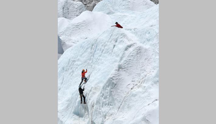 Amputee makes history on Everest summit