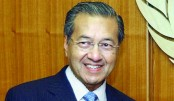 Mahathir to stay up to 2 years as Malaysia leader, no deal for Najib