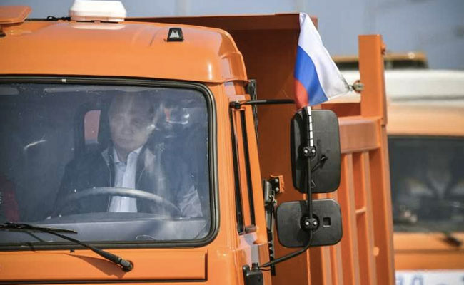Russia's Putin drives truck to open 19-km bridge linking Moscow with annexed Crimea (Video)