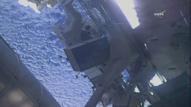 Spacewalking astronauts tackle pump work at space station