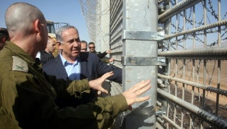 Israel builds 'missile net' on border to protect airport