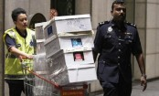 Malaysia police seize cash and luxury goods in Najib-linked raids